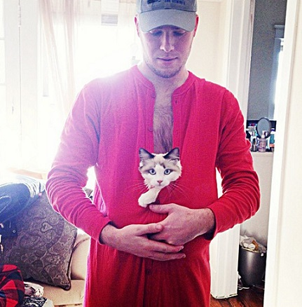 Guy with cat in his onsie