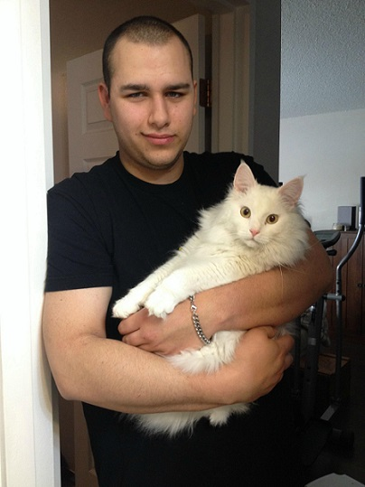 White cat held by man