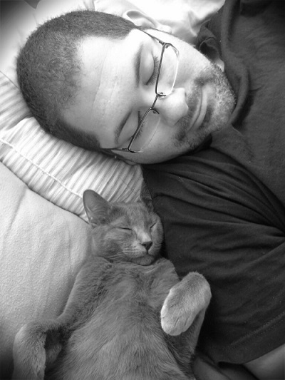 Kitty sleeping with man