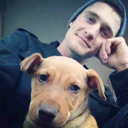 Cute guy and his puppy