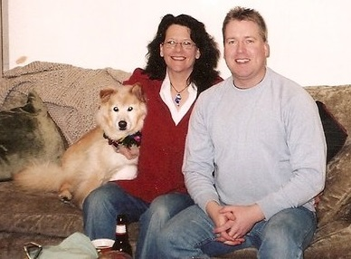 Klyde the husky mix with his owners Pat and Aaron