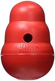 Kong Wobbler food-dispensing puzzle toy to stop a dog's whining